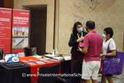A representative from the University of Reading Malaysia speaking with visitors