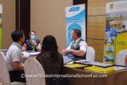 Visitors speaking with The International School of Penang (Uplands) representatives