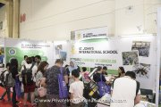 Visitors at St. John's International School's booth