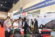 Parents at Spectrum International Islamic School's booth