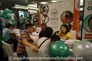 A family wanting to know more about Straits International School