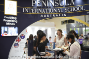 A Peninsula International School Australia representative interacting with visitors