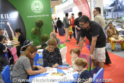 A representative from Straits International School interacting with visitors