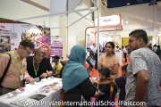 Visitors at Alnoor International School's booth