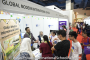 Visitors at Global Modern International School's booth