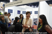 Oxford International AQA Examinations representatives interacting with visitors