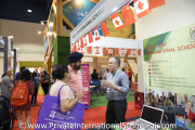 A Maple Leaf International Schools representative speaking to visitors