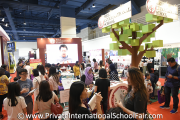 The crowd at HELP International School's booth
