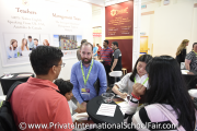 Visitors speaking to a Kingsgate International School representative