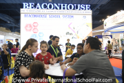 Visitors at the Beaconhouse Schools booth