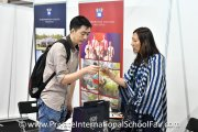 A visitor speaking to a Marlborough College Malaysia representative