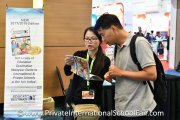 A visitor purchasing the Education Destination Malaysia guidebook