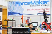 A child exploring the various 3D printed items at Forcemaker's booth