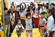 Kids at BeeBop Circus's swing attraction at their booth