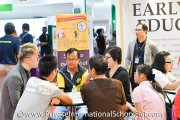 Visitors getting important information on international schools