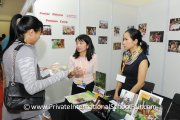 A visitor talking to representatives from YK Pao School, Shanghai, China